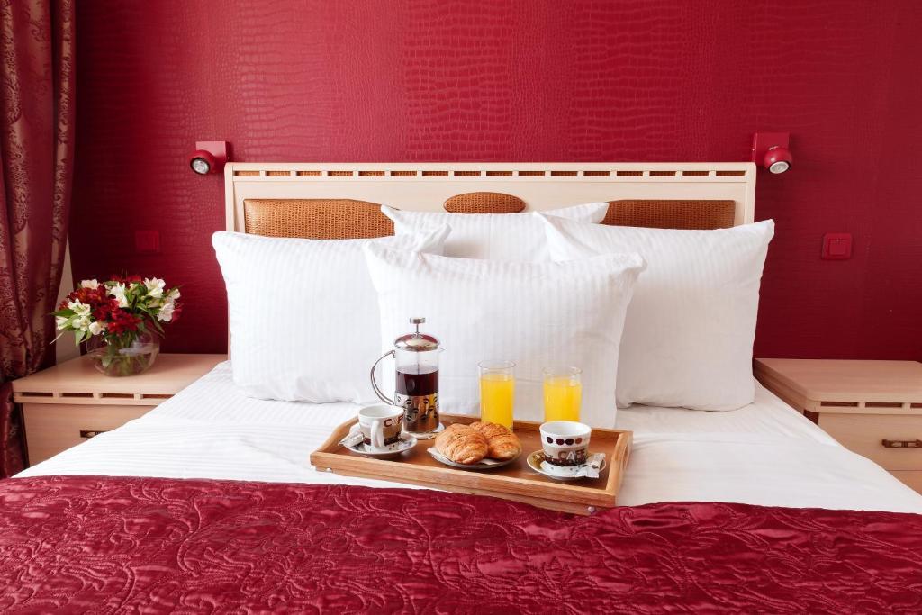 Кровать или кровати в номере Гостиница Африка