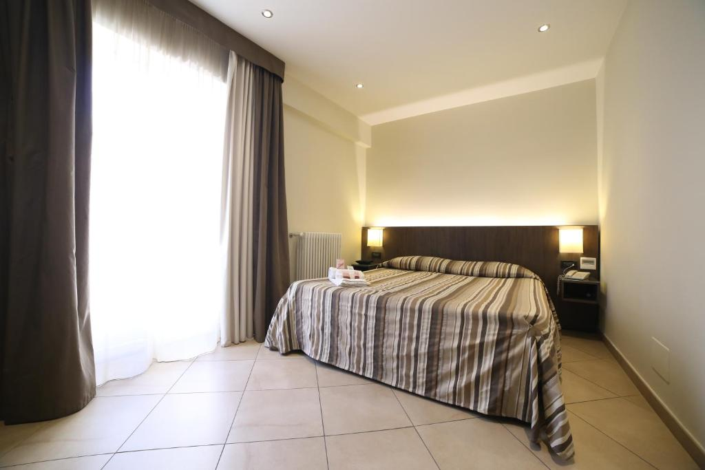 A bed or beds in a room at BB 10 Serpotta