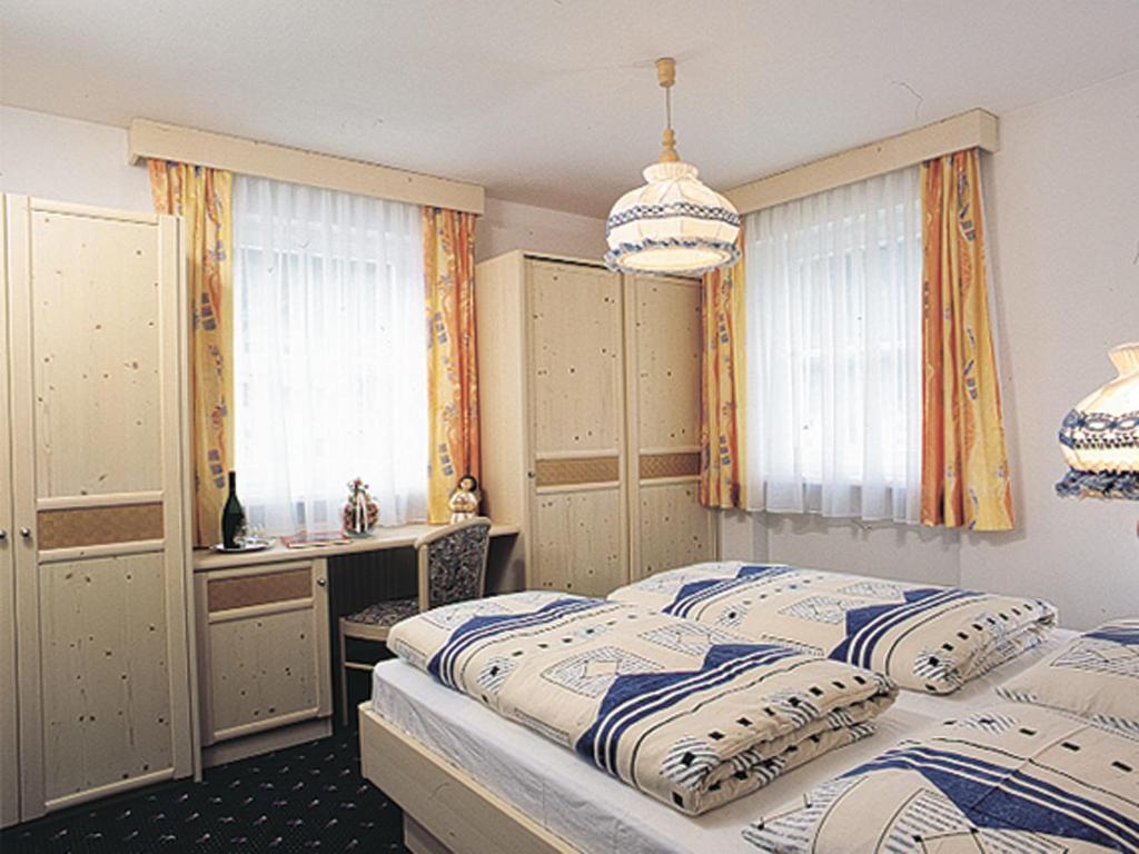 Кровать или кровати в номере Appartmenthotel Residence Elvis