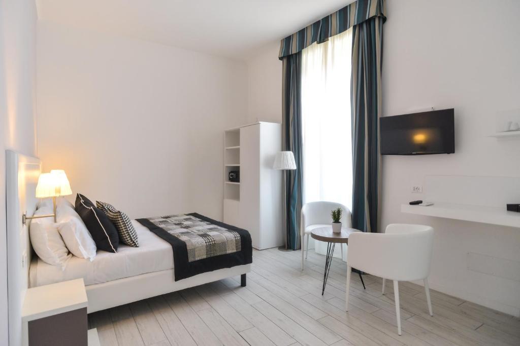 Télévision ou salle de divertissement dans l'établissement Lata Luxury Rooms