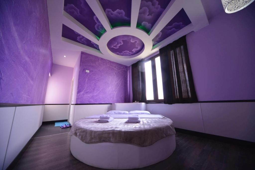 Postelja oz. postelje v sobi nastanitve Hotel Lotus