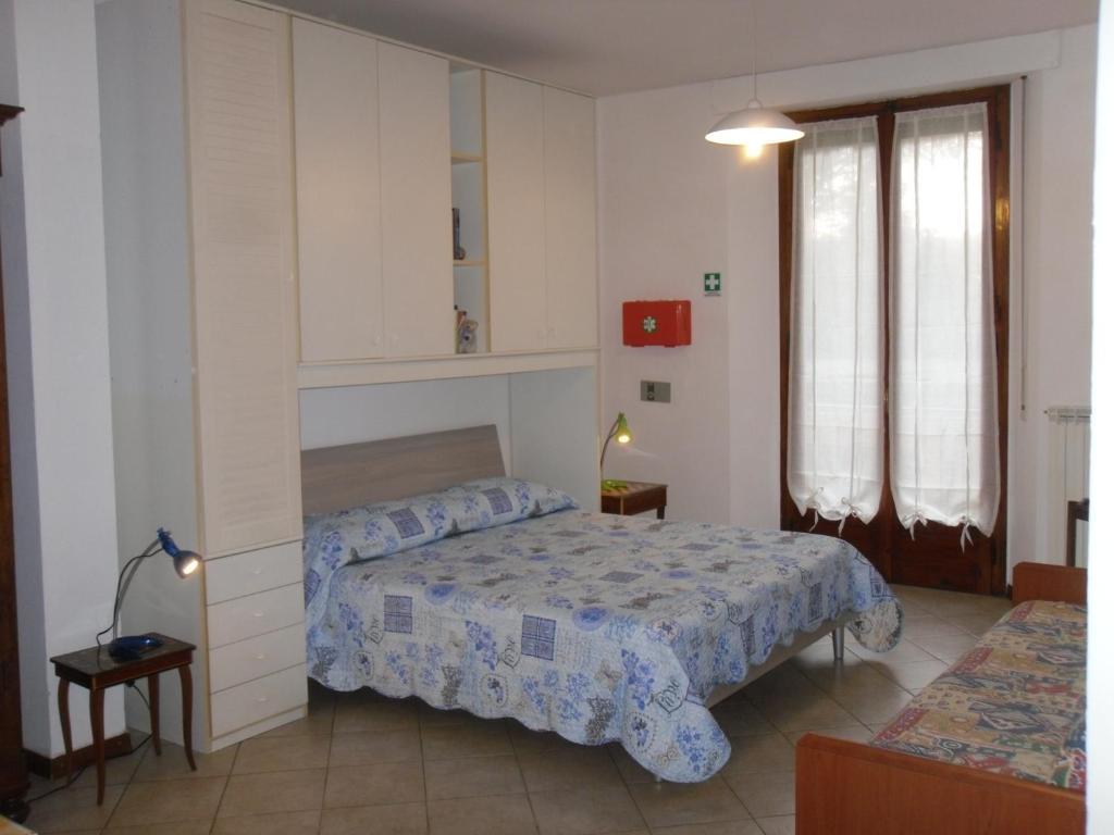 """Cama o camas de una habitación en Appartamento """"La Piccola"""""""
