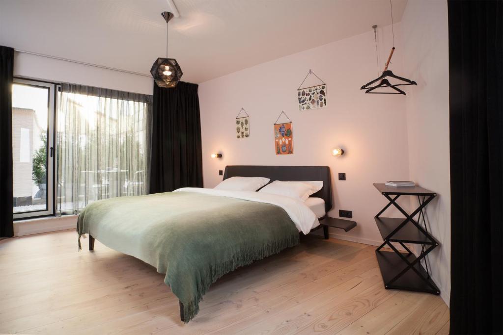 Een bed of bedden in een kamer bij B&B Lucy in the Sky