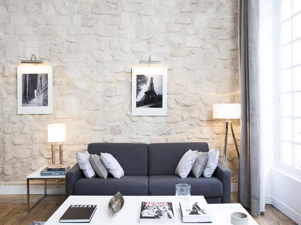 A seating area at Luxury 2 Bedrooms Le Marais I by Livinparis
