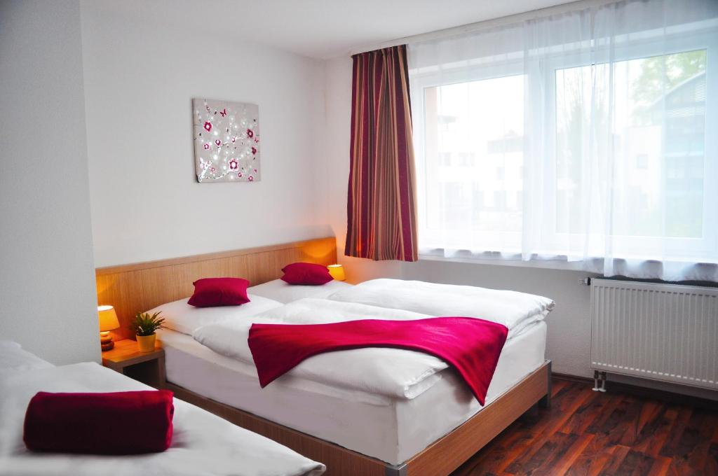 Ein Bett oder Betten in einem Zimmer der Unterkunft Hotel Platinium