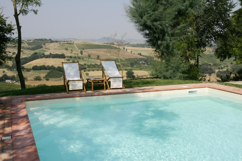 The swimming pool at or near Locanda Della Fortuna