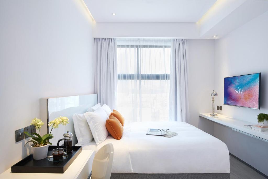 Кровать или кровати в номере Hotel Sav