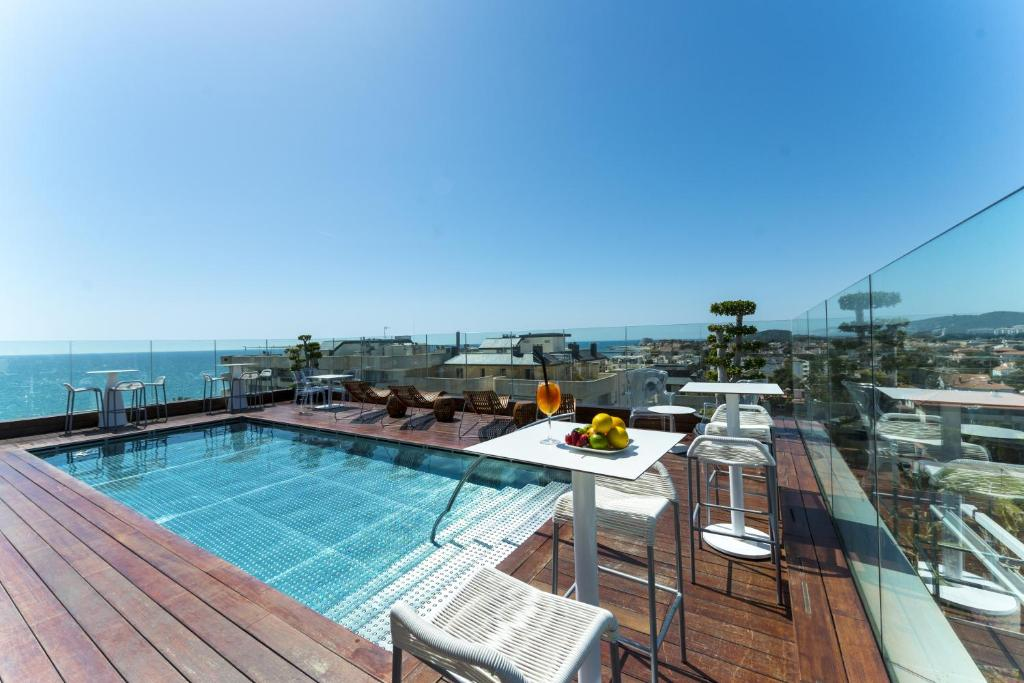 The swimming pool at or near Hotel MiM Sitges