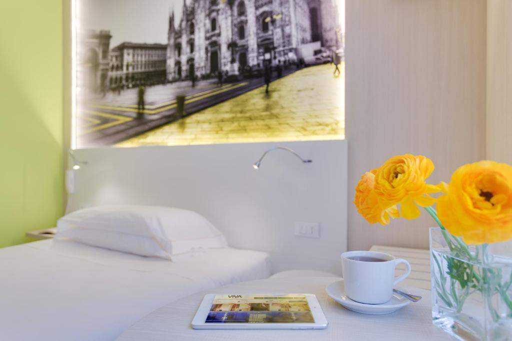 A bed or beds in a room at VIVA Hotel Milano
