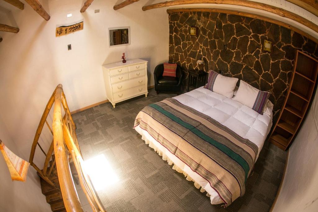 Cama ou camas em um quarto em Parina Atacama Apart Hotel