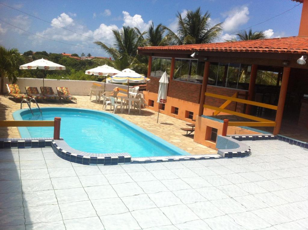 The swimming pool at or close to Pousada Zekas
