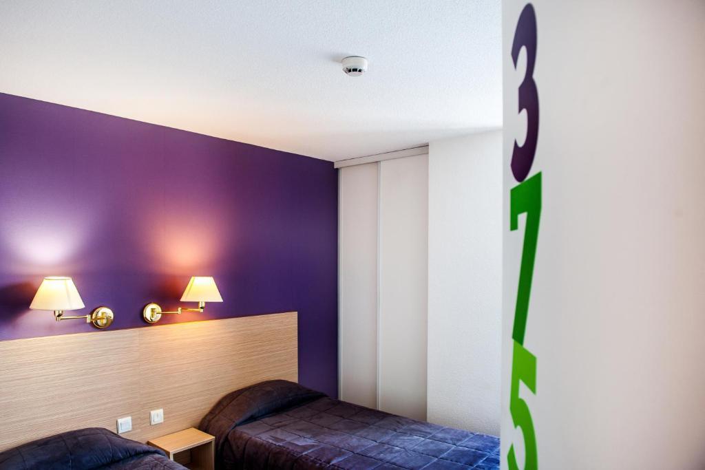 Un ou plusieurs lits dans un hébergement de l'établissement Hôtel Continental