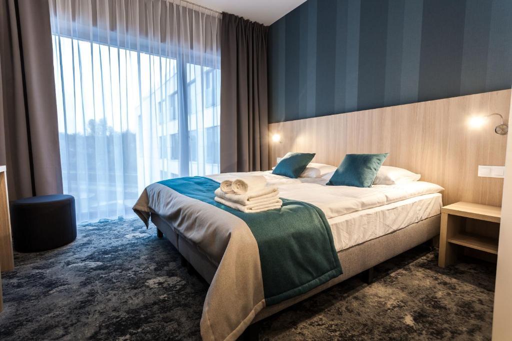 Lova arba lovos apgyvendinimo įstaigoje Hotel Zatoka