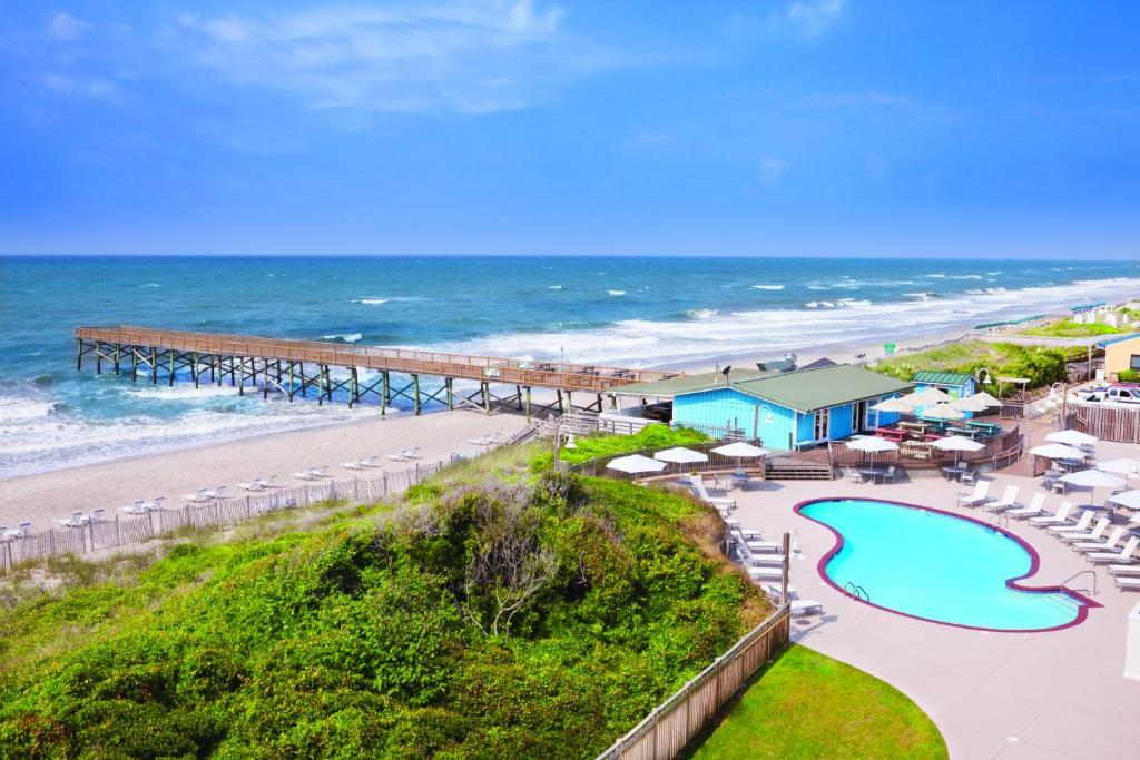 A view of the pool at DoubleTree by Hilton Atlantic Beach Oceanfront or nearby
