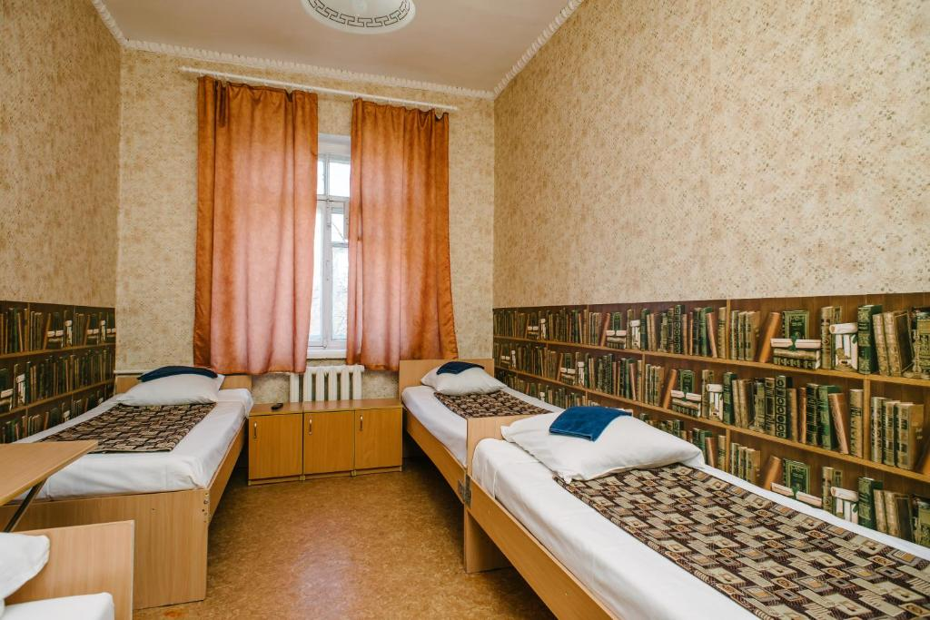 Кровать или кровати в номере Звезда Хостел