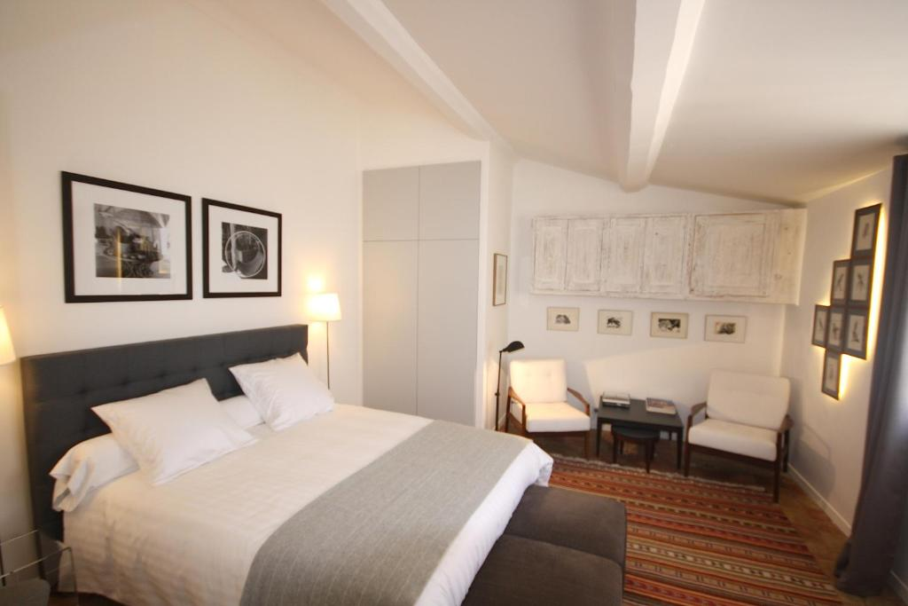 A bed or beds in a room at Appartement Quartier Mazarin