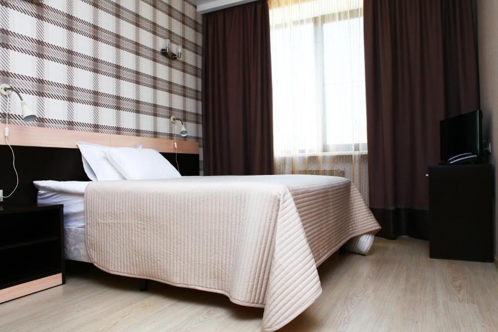 Кровать или кровати в номере Гостиница Спутник