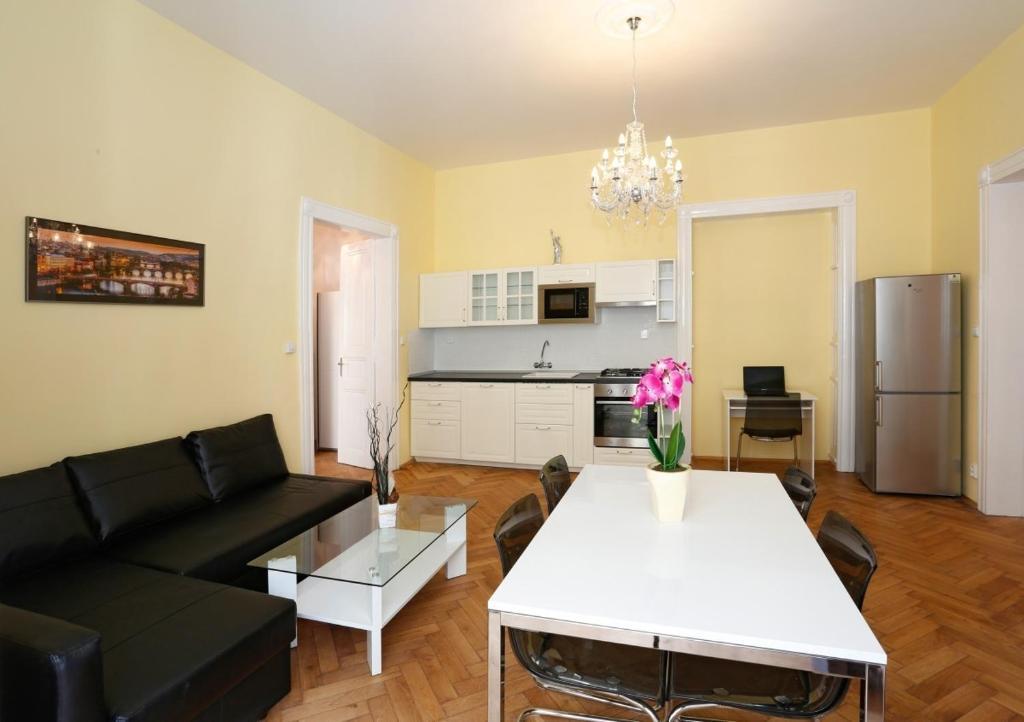 A kitchen or kitchenette at Apartment Pštrossova