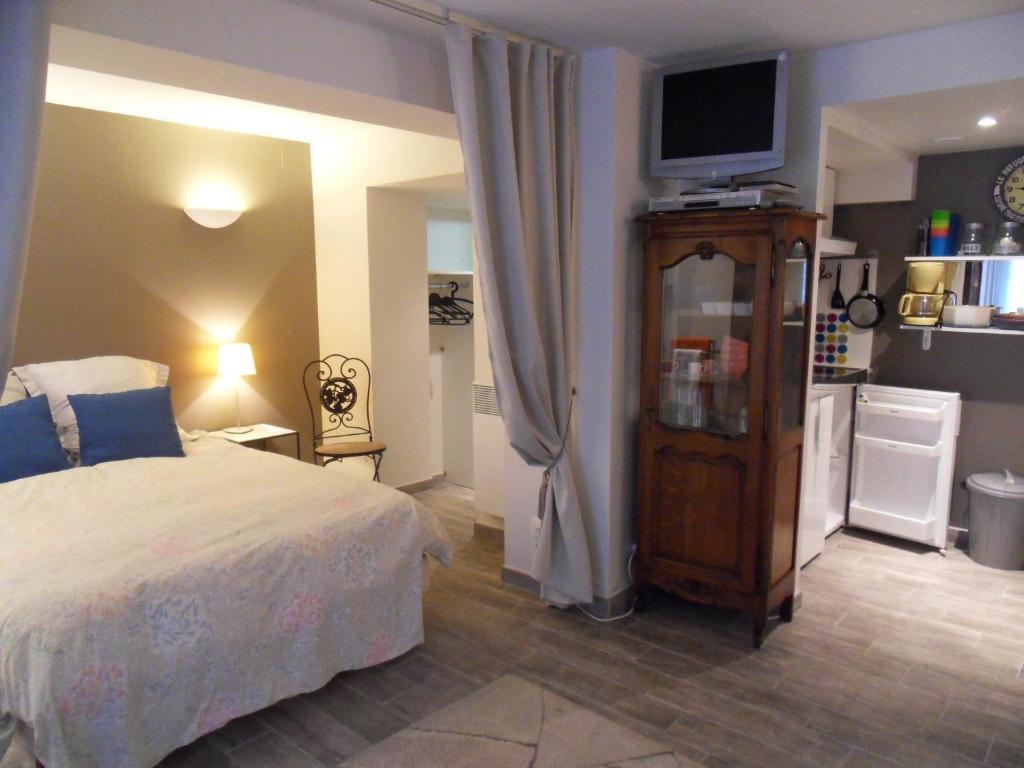 Un ou plusieurs lits dans un hébergement de l'établissement Studio des Musiciens - quartier Orangerie