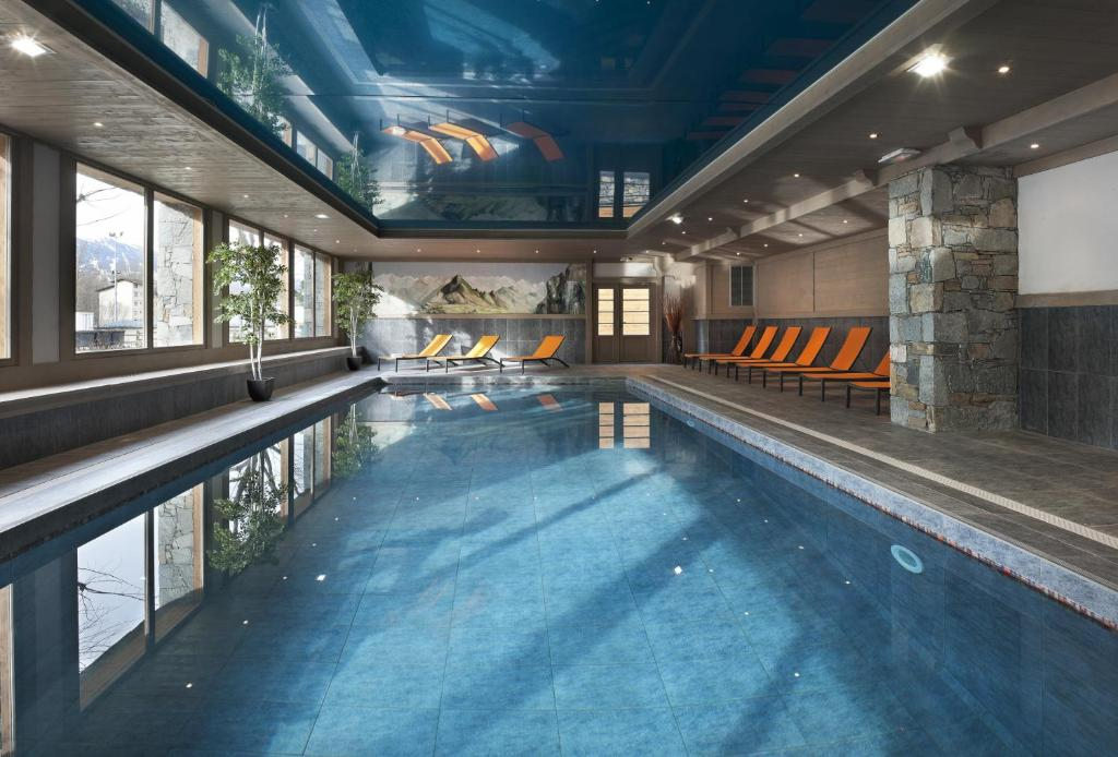The swimming pool at or near CGH Résidences & Spas Le Coeur d'Or