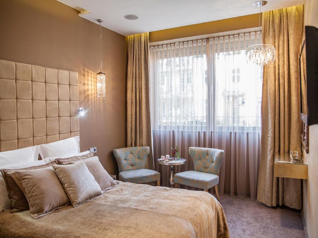 Łóżko lub łóżka w pokoju w obiekcie Soleil Boutique H