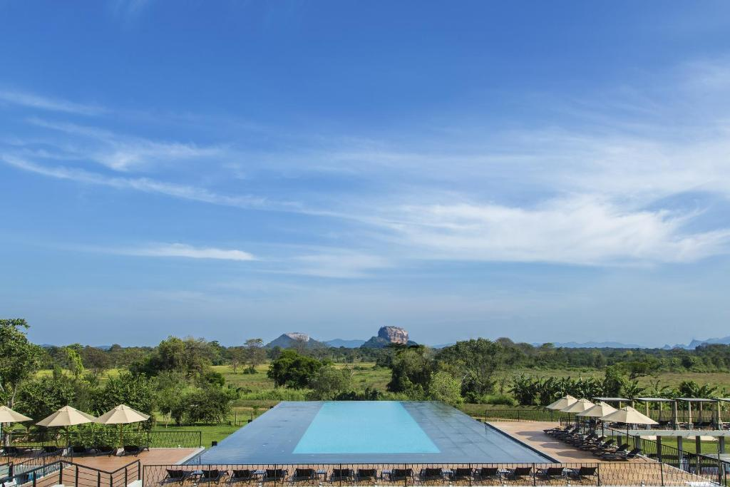 A view of the pool at Aliya Resort and Spa or nearby