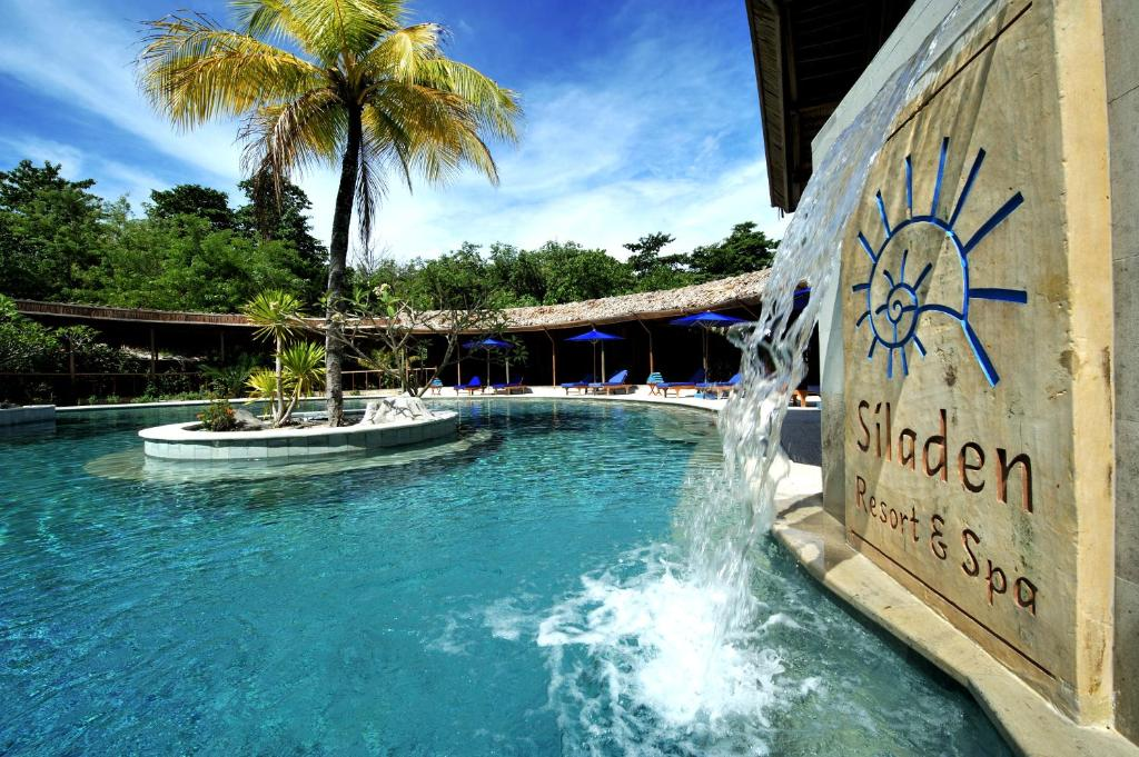 The swimming pool at or near Siladen Resort & Spa