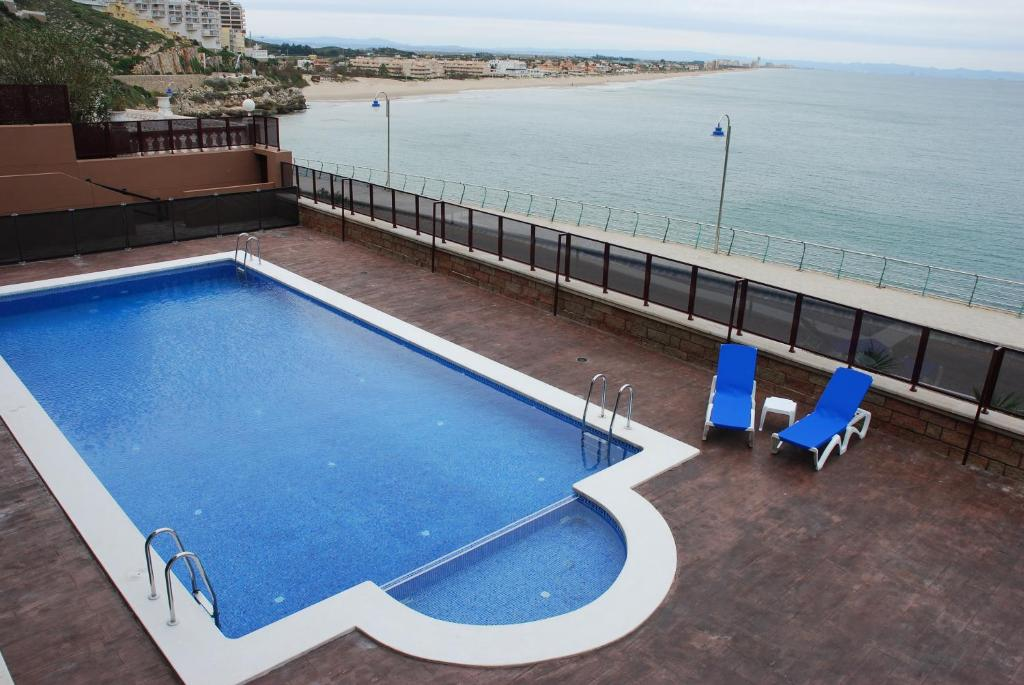 A view of the pool at Aparthotel El Faro or nearby