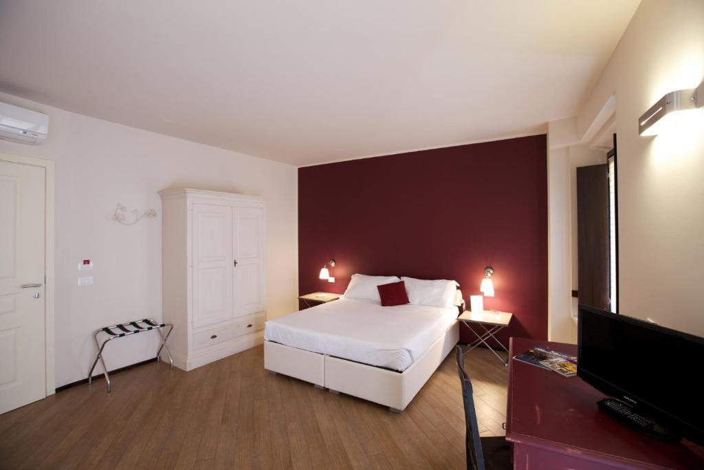Letto o letti in una camera di La Residenza Leon D'Oro