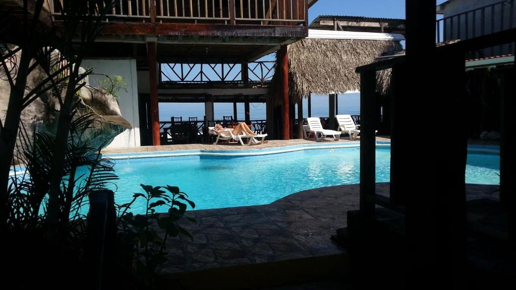 The swimming pool at or near La Delphina Bed and Breakfast Bar and Grill