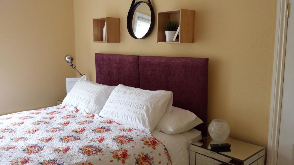 A bed or beds in a room at The Railway Inn Westerfield