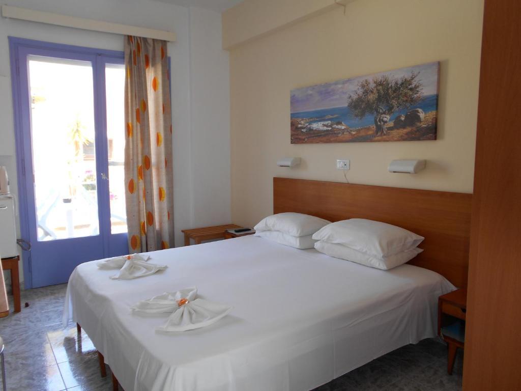 Krevet ili kreveti u jedinici u okviru objekta Florida Hotel