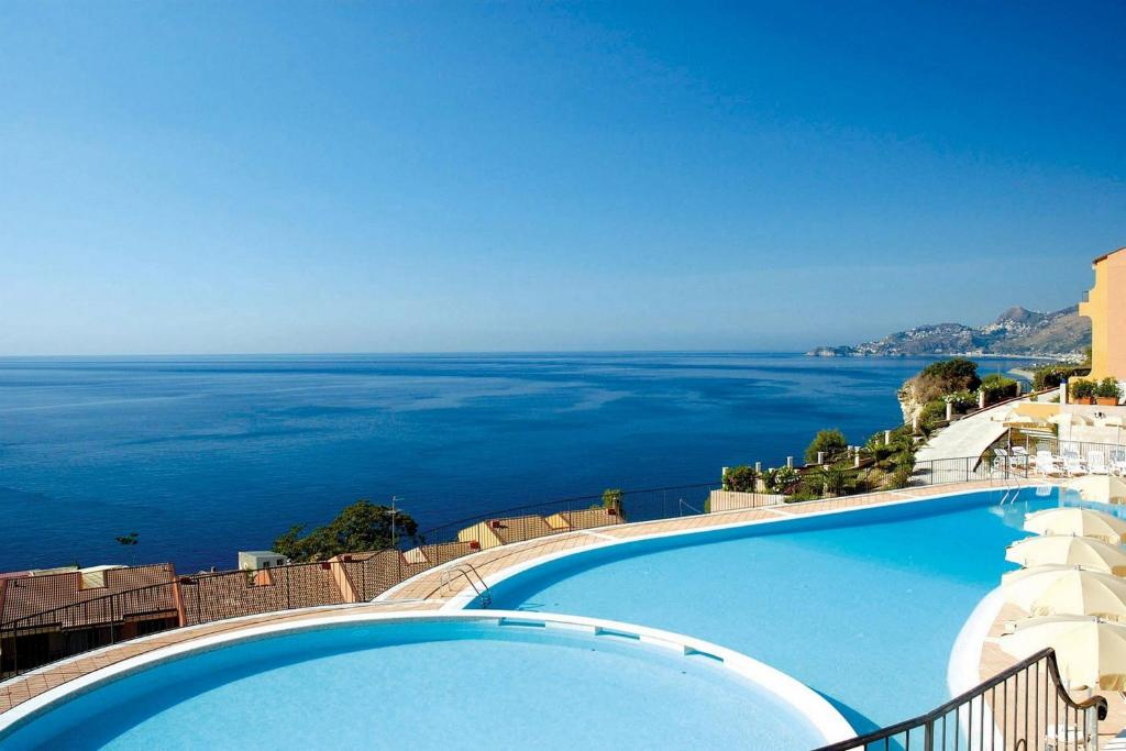 A view of the pool at Capo Dei Greci Taormina Coast Hotel & SPA or nearby