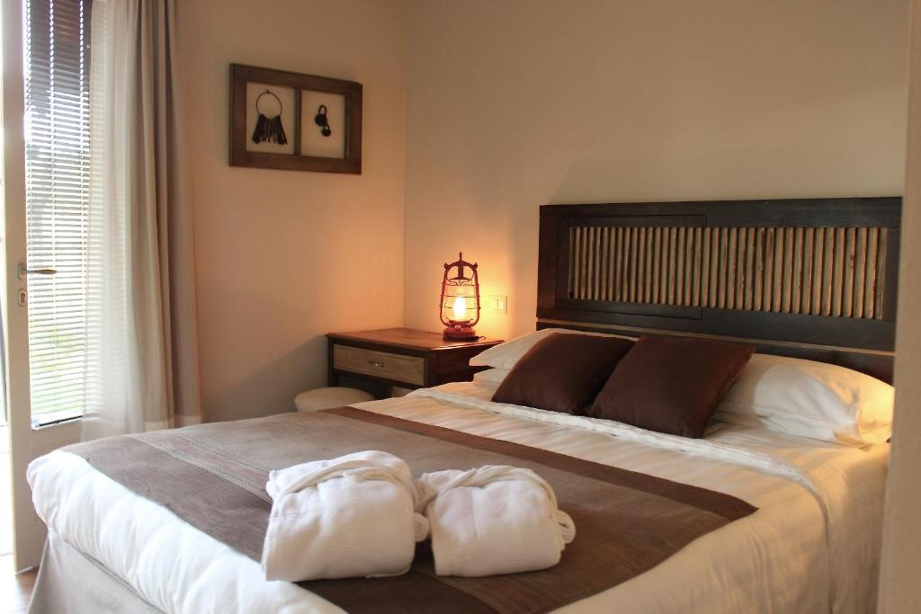 A bed or beds in a room at B&B Kapì Country
