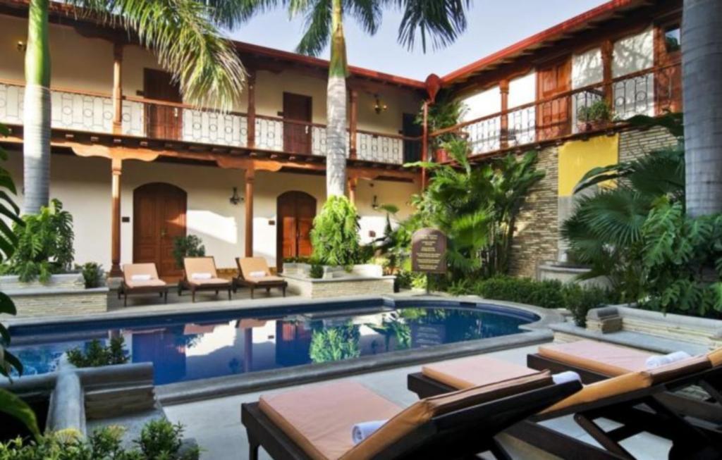 The swimming pool at or near Hotel Plaza Colon - Granada Nicaragua