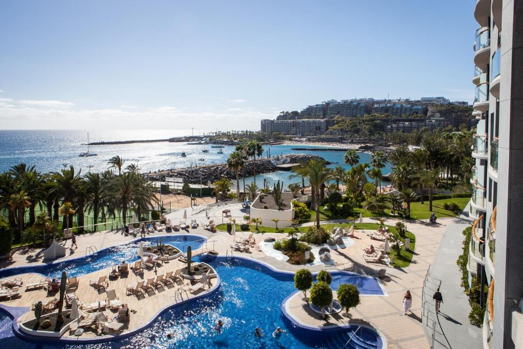 A view of the pool at Radisson Blu Resort Gran Canaria or nearby