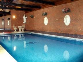 The swimming pool at or near Crown & Cushion Hotel