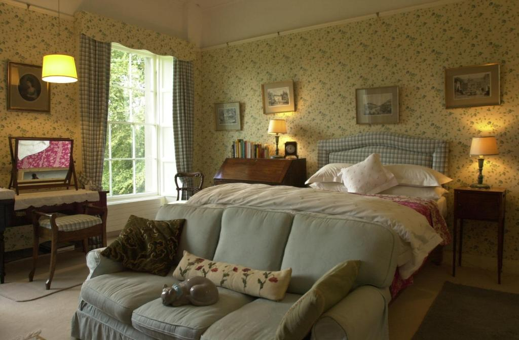 A bed or beds in a room at Ballyduff House
