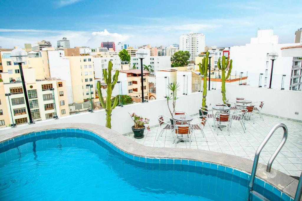 A view of the pool at Embajadores Hotel or nearby