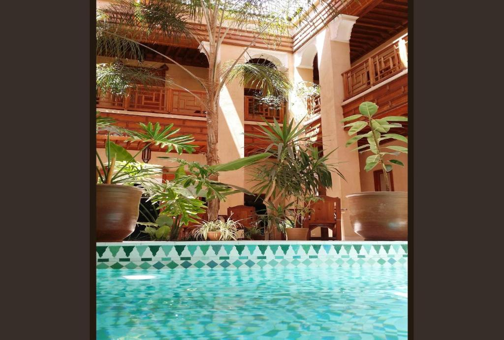 The swimming pool at or near Riad Al Ksar & Spa