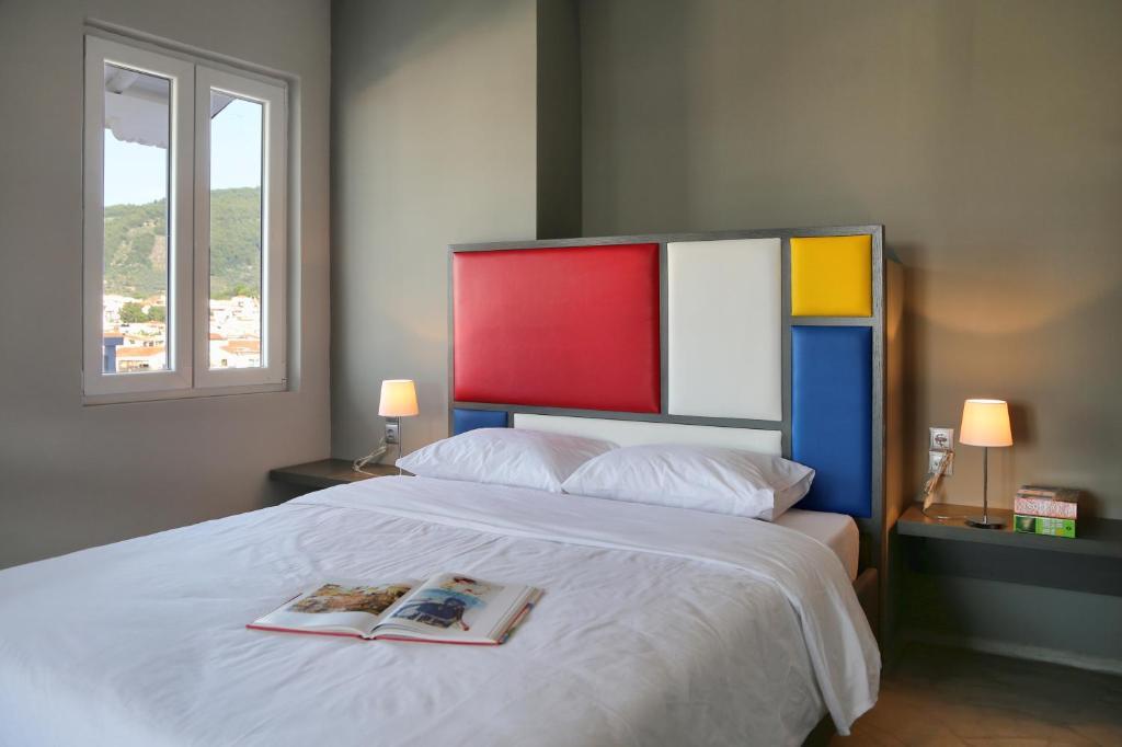 Ένα ή περισσότερα κρεβάτια σε δωμάτιο στο Design Architectonika