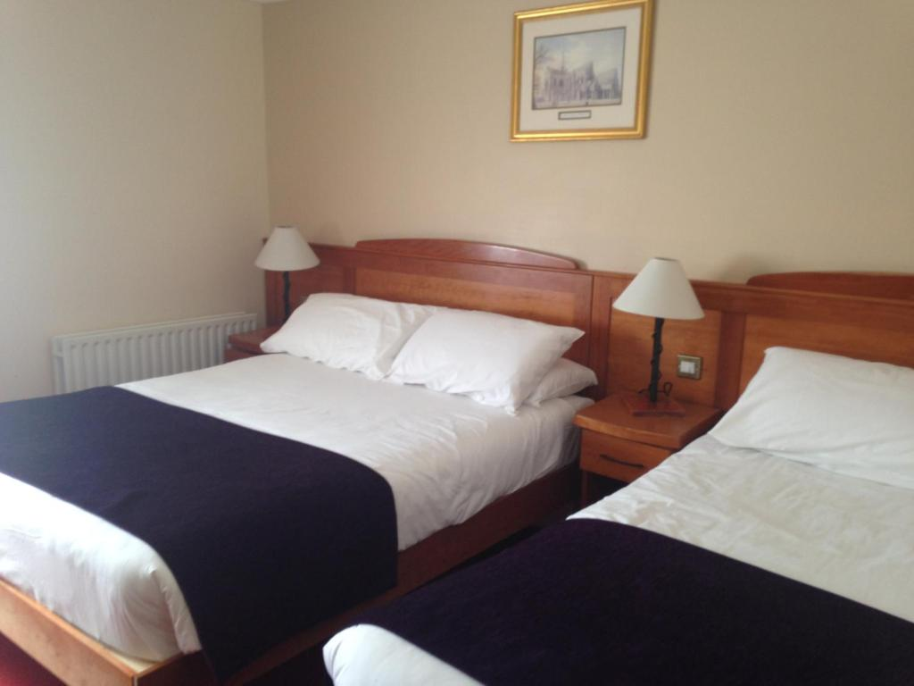 A bed or beds in a room at Kilford Arms
