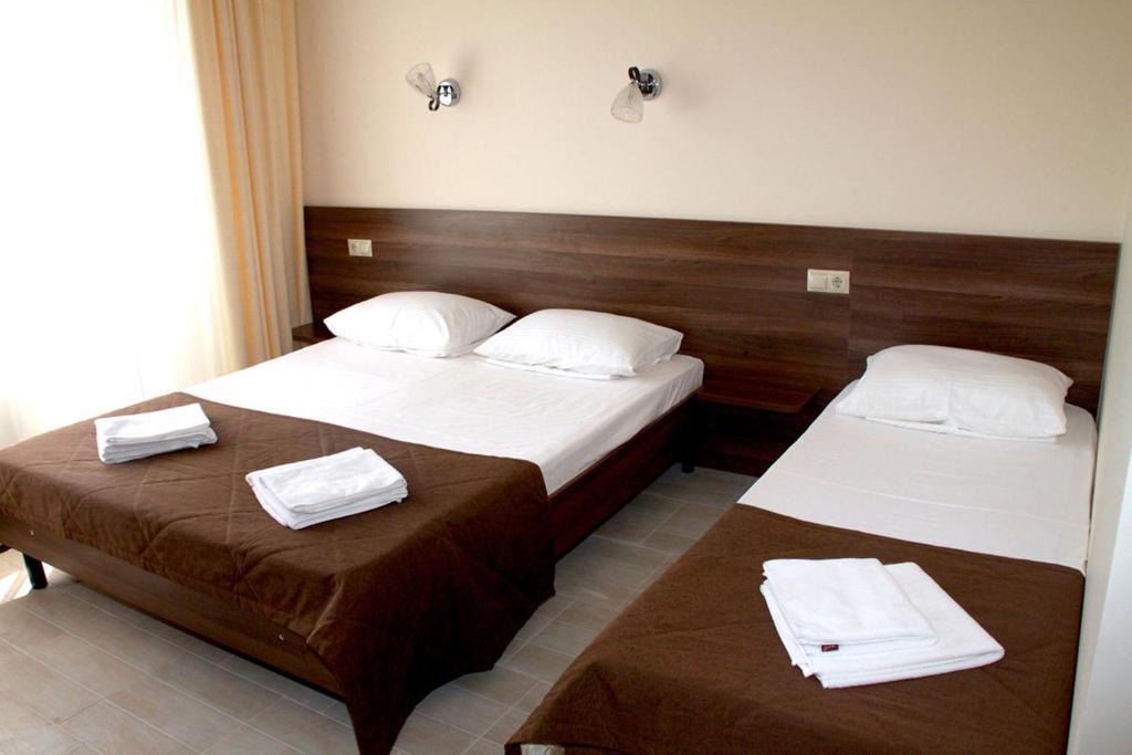 Кровать или кровати в номере Hotel Morskaya Volna