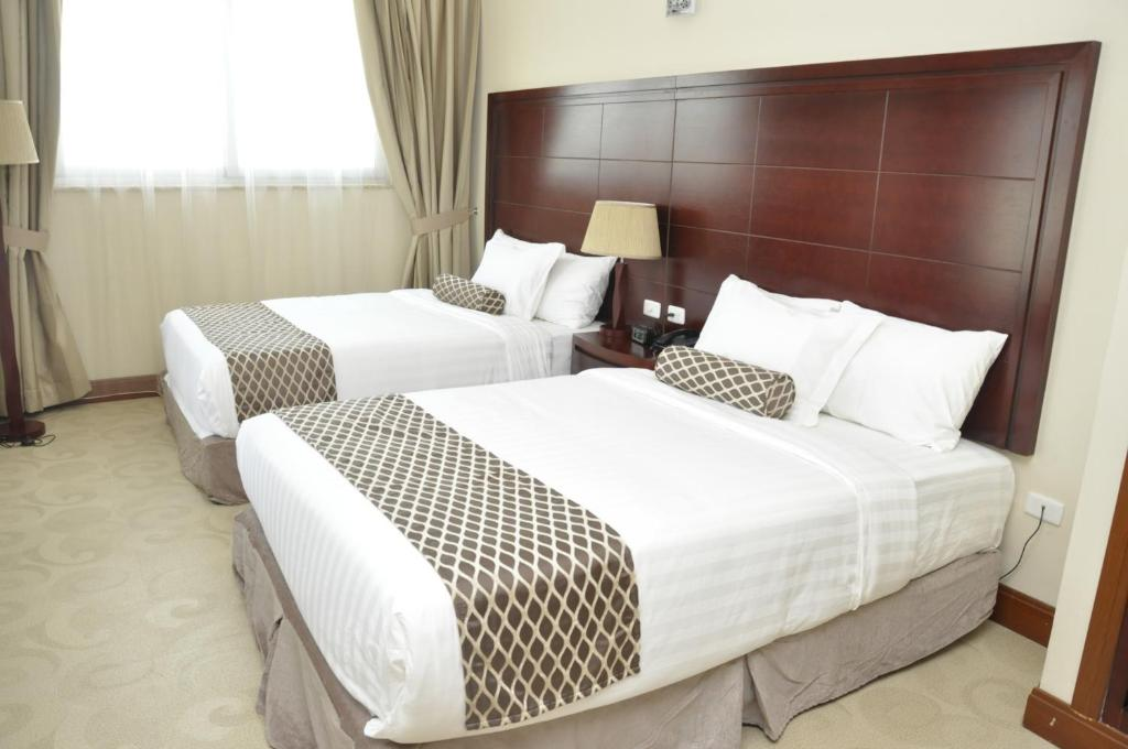 Addissinia Hotelにあるベッド
