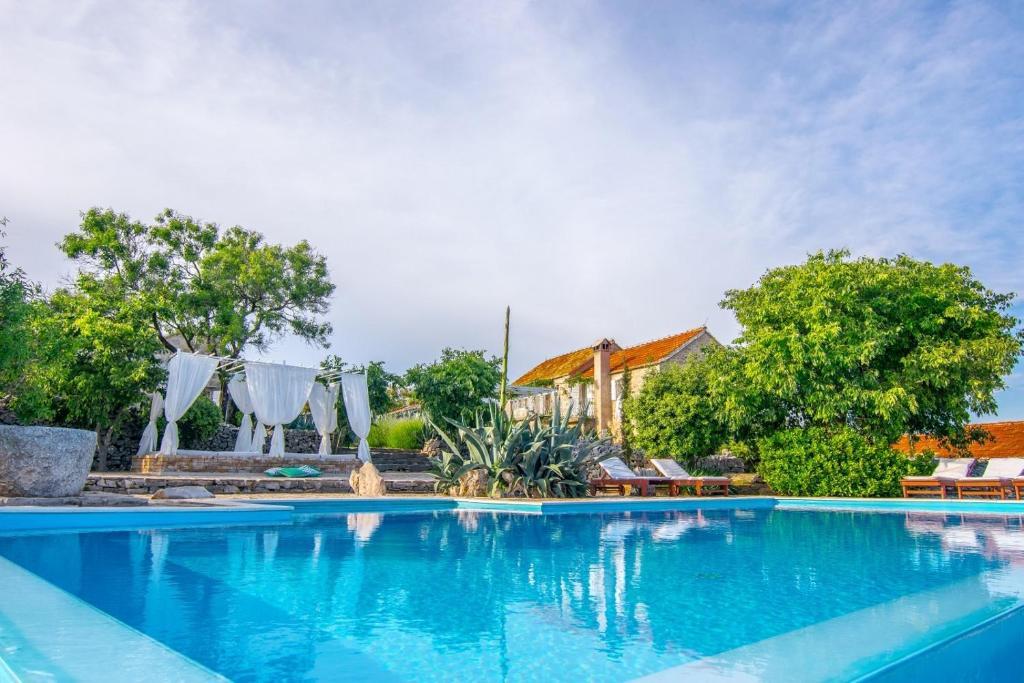 The swimming pool at or near Sea View Villa Dvori Sv. Jurja