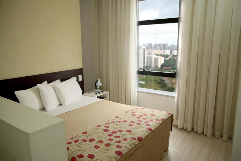 A bed or beds in a room at Iguatemi Business & Flat
