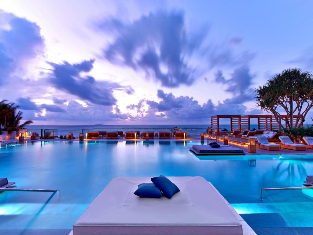 An outdoor swimming pool at the 1 Hotel South Beach.