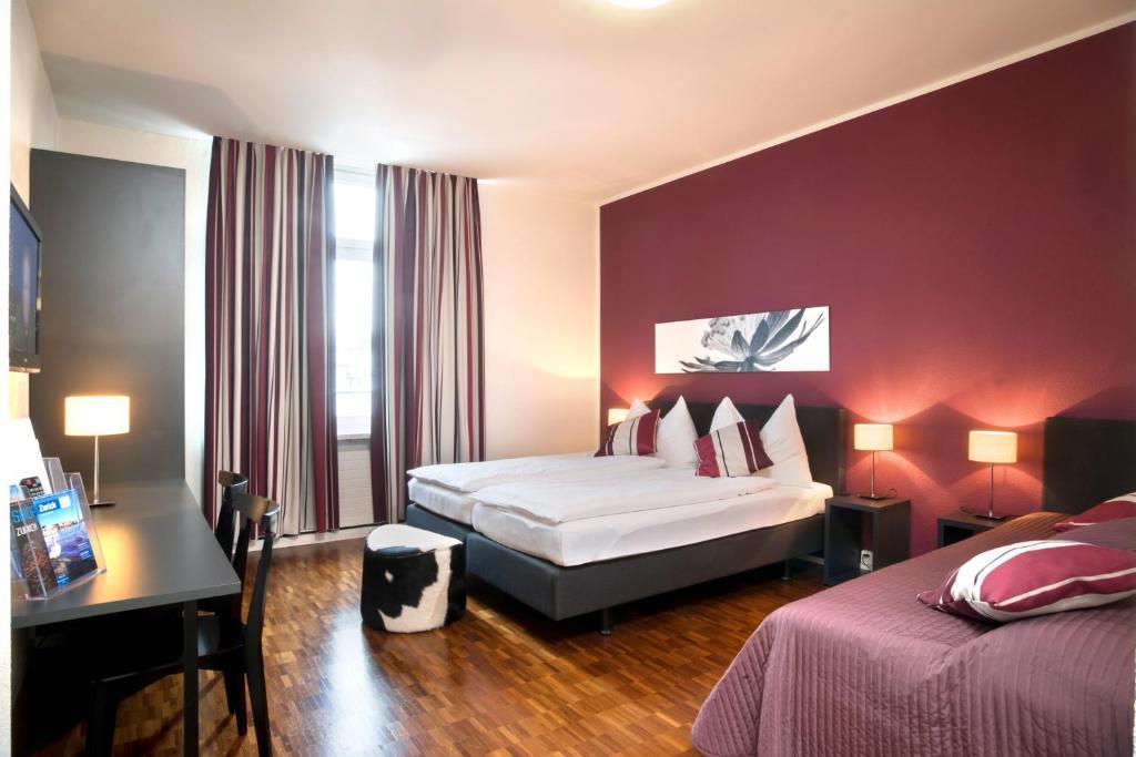 Ein Bett oder Betten in einem Zimmer der Unterkunft Hotel Hottingen
