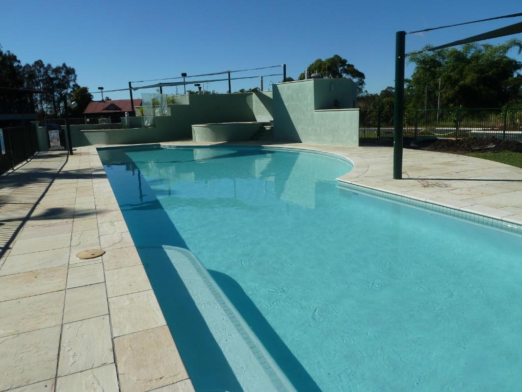 The swimming pool at or near McNevins Logan Park Motel