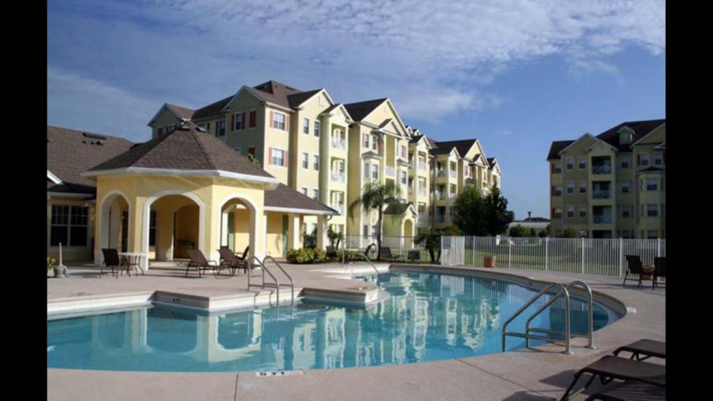 The swimming pool at or close to Cane Island Luxury Condo
